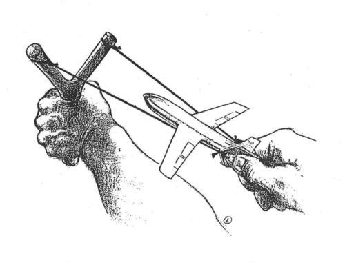 mãos - estilingue - avião